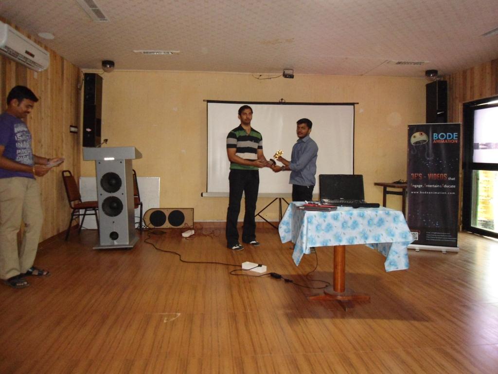 Mr. Srinivas Raghav has given the trophy to the winners of 2012 - 13